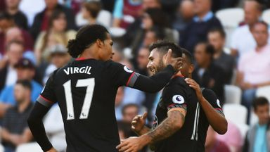 Charlie Austin of Southampton (10) celebrates with Virgil van Dijk (17) as he scores their first goal during the Premier League match at West Ham