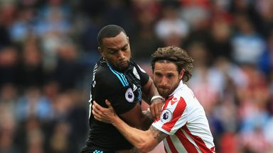 Joe Allen battles with Matt Phillips in the 1-1 draw with West Brom