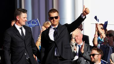 Justin Rose (left) and Henrik Stenson of Europe react during the 2016 Ryder Cup Opening Ceremony