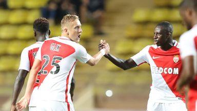 Monaco defender Kamil Glik (L) celebrates after scoring
