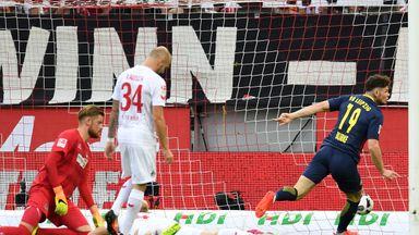 Oliver Burke wheels away in celebration after scoring for Leipzig