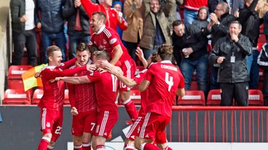 Aberdeen's players mob James Maddison after his late winner against Rangers