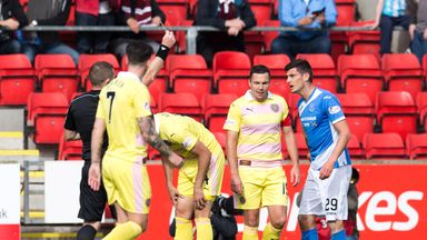 Referee John Beaton shows St Johnstone's Graham Cummins (right) the yellow card during the win over Hearts