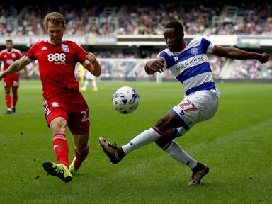 Jonathan Spector of Birmingham blocks a cross from QPR's Olamide Shodipo