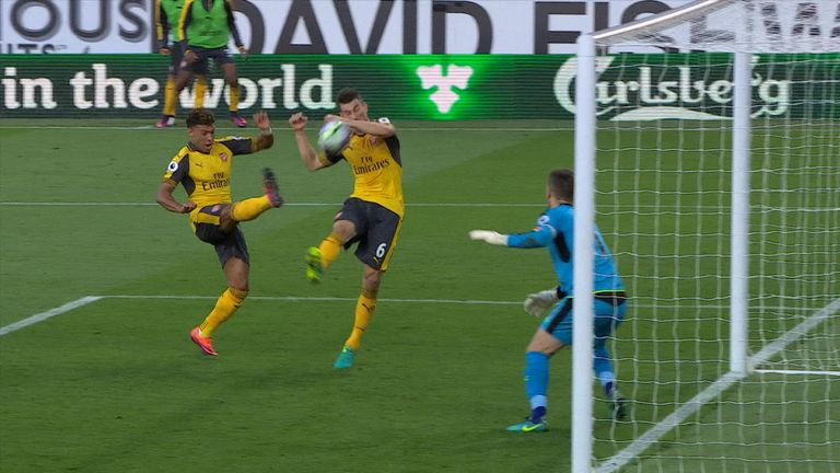 The ball hits Koscielny's hand before dropping over the line for Arsenal's late winner