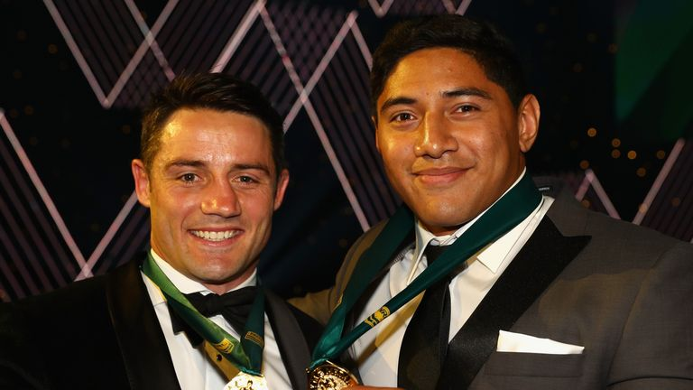 Cooper Cronk and Jason Taumalolo pose with the Dally M medals