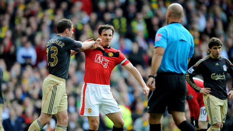 Jamie Carragher and Gary Neville square off after Howard Webb awards a penalty to Manchester United in 2010