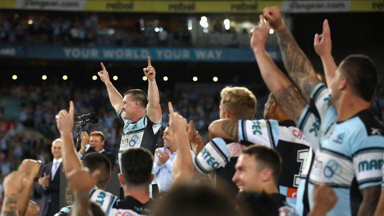 Paul Gallen celebrates with team-mates after winning the 2016 NRL Grand Final