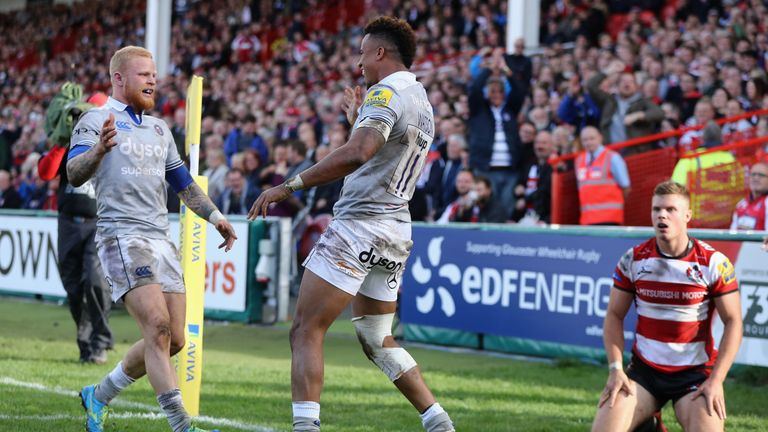 Anthony Watson celebrates with Tom Homer (left) after scoring Bath's first try at Kingsholm