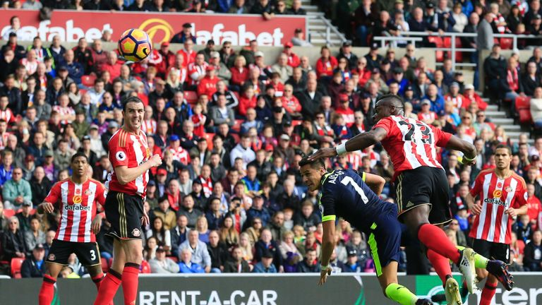 Alexis Sanchez heads home Arsenal's first goal against Sunderland