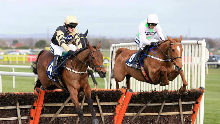 Nichols Canyon ridden by Paul Townend (left) and Annie Power ridden by Ruby Walsh compete during the Doom Bar Aintree Hurdle in April 2016.