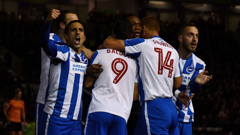 Sam Baldock of Brighton is mobbed after scoring his team's first goal against Wolves