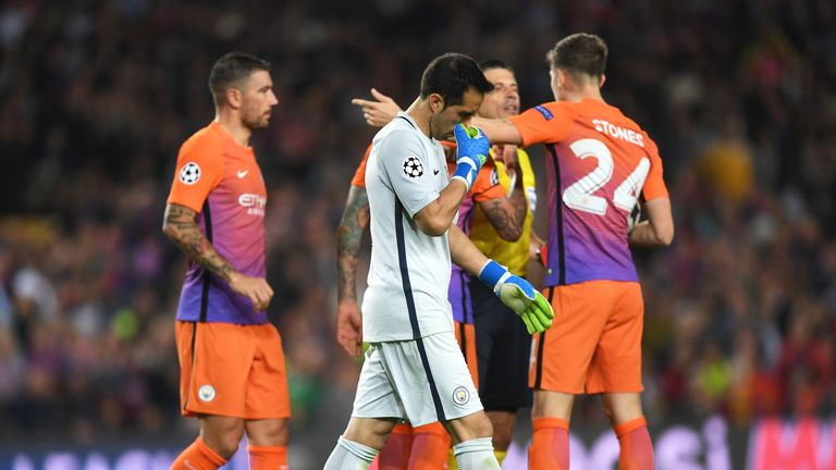 Claudio Bravo leaves the pitch after seeing red for handling outside his area