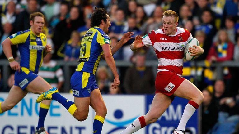 Dom Crosby (right) helped the the Warriors defeat Wigan in the Grand Final earlier this month
