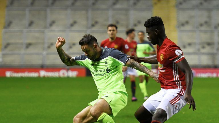 Danny Ings and Axel Tuanzebe in action during the Premier League 2 match between Manchester United and Liverpool