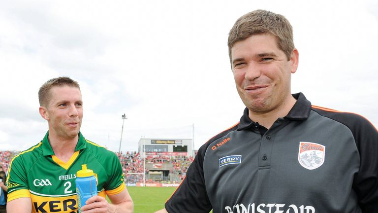 Eamonn Fitzmaurice shakes hands with Marc Ó Sé after Kerry's Munster final win over Cork in 2013