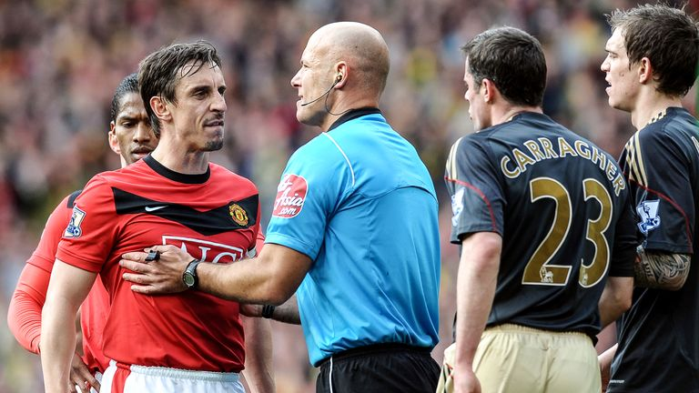 Howard Webb is forced to play peacemaker between Gary Neville and Jamie Carragher