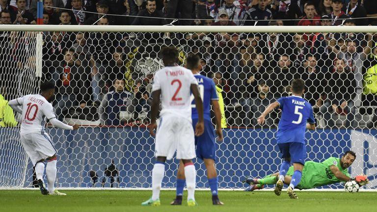 Buffon (R) saved Alexandre Lacazette's penalty