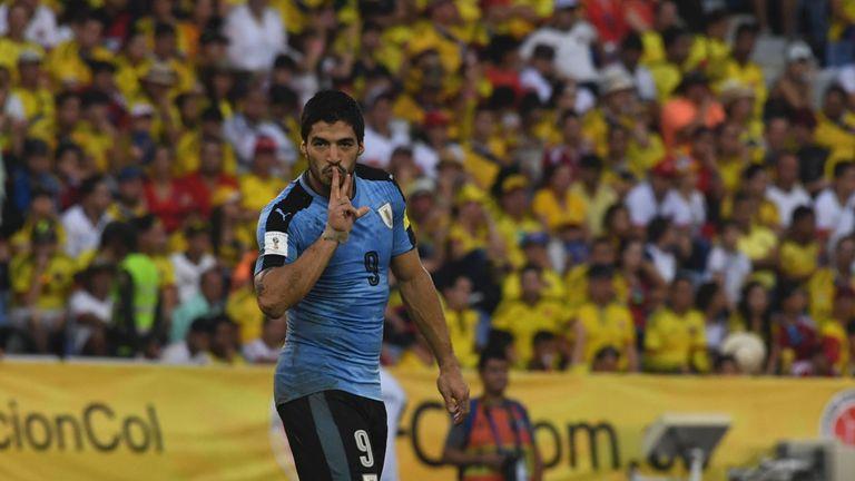 Luis Suarez celebrates his goal for Uruguay against Colombia