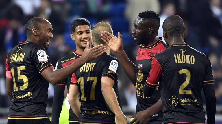 Guimgamp players celebrate after beating Lyon