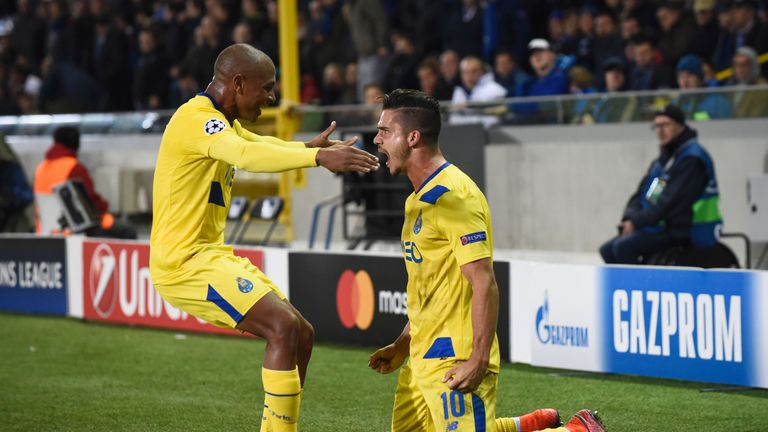 Porto forward Andre Silva (R) celebrates with team-mate Yacine Brahimi  after scoring a late penalty