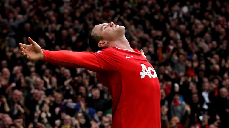 Rooney celebrates after scoring his famous goal from an overhead kick against Man City in 2011