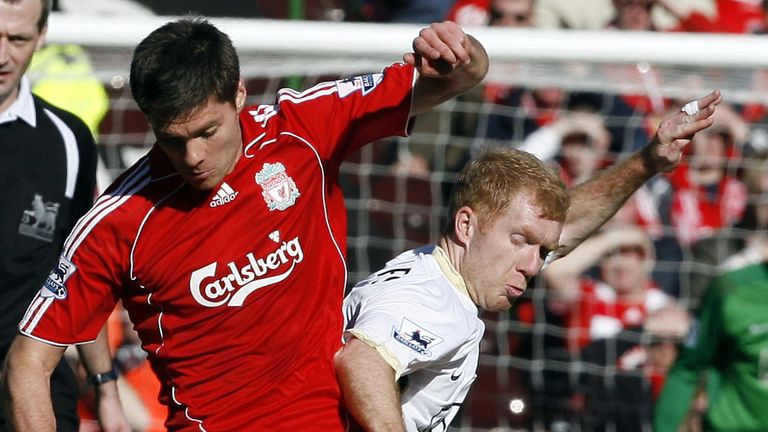 Paul Scholes and Xabi Alonso both feature in the respective XIs