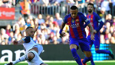 Barcelona forward Neymar rides a challenge from Deportivo La Coruna's Guilherme dos Santos