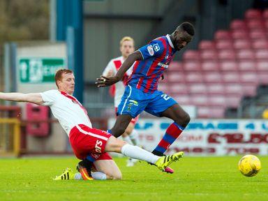 Kilmarnock's Scott Boyd (left) battles for the ball against Inverness' Lonsana Doumbouya