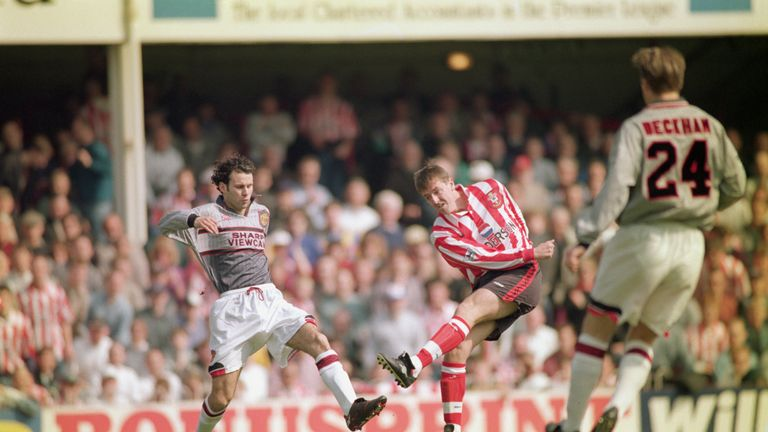 SOUTHAMPTON - APRIL 13 1996:  Matthew Le Tissier of Southampton shoots at goal as Ryan Giggs of Manchester United makes a challenge