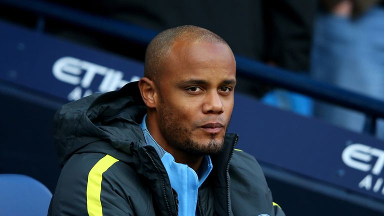 MANCHESTER, ENGLAND - OCTOBER 15: Vincent Kompany of Manchester City takes his seat on the bench during the Premier League match between Manchester City an