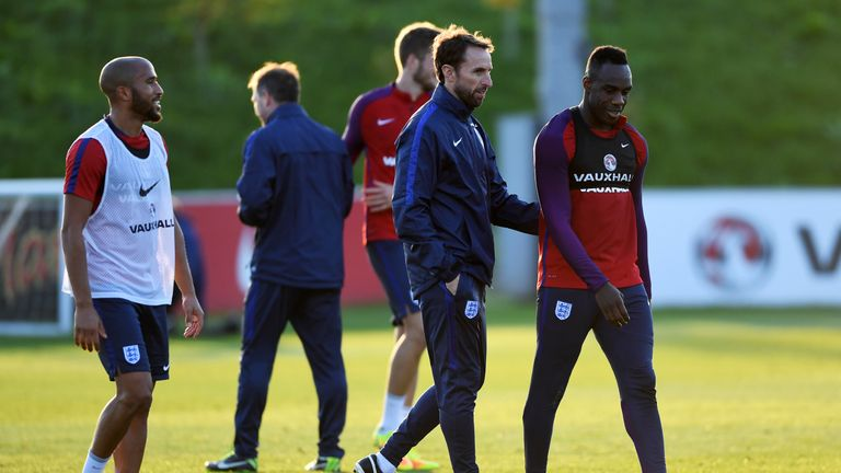 Gareth Southgate speaks with Michail Antonio during an England training session at St George's Park