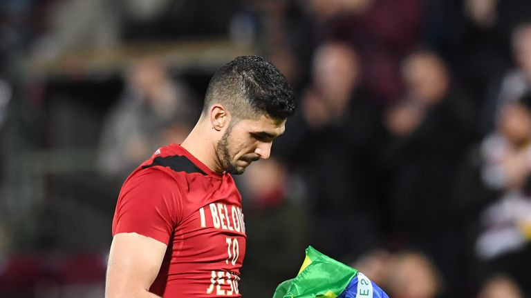Hearts' Igor Rossi holds the Brazilian flag at the end of the game