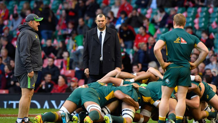 Michael Cheika (C) is focused on his own side's scrummaging
