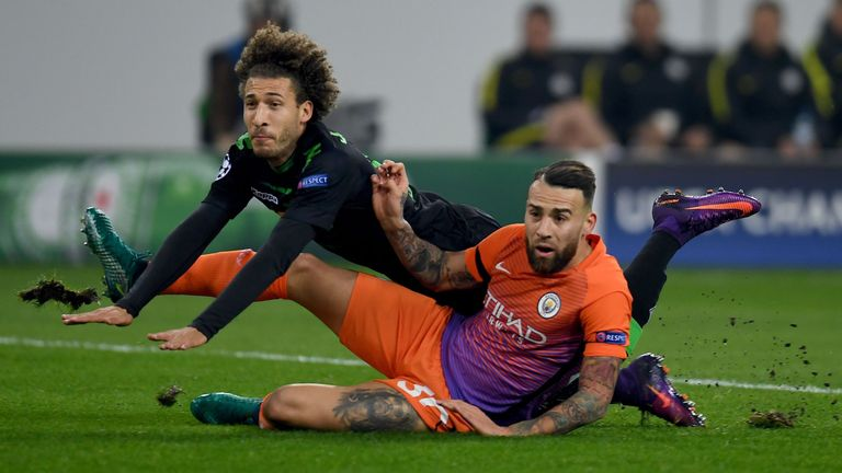Fabian Johnson and Nicolas Otamendi tangle during the game