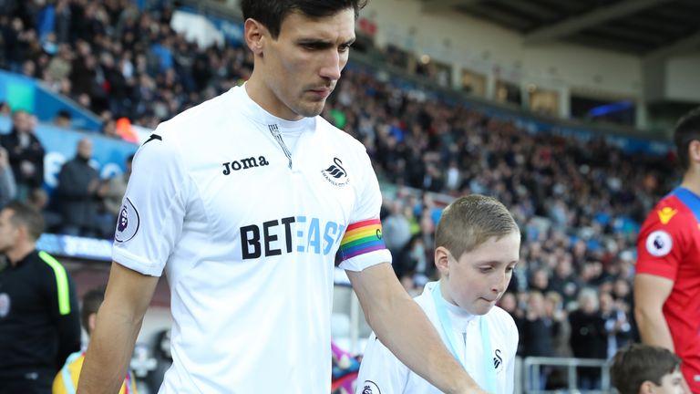 Jack Cork wore a rainbow colour captain's arm band for Swansea last season