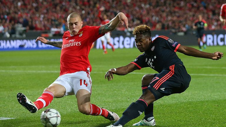 Victor Lindelof of Benfica challenges David Alaba of Bayern Munich