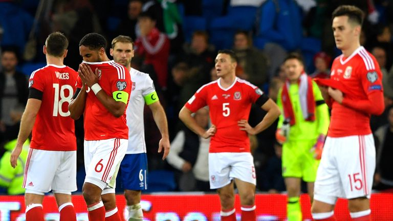Wales players show their dejection after draw with Serbia