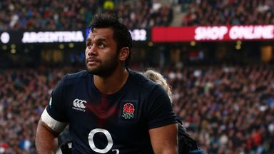 England's number 8 Billy Vunipola is helped from the field during England's match with Argentina