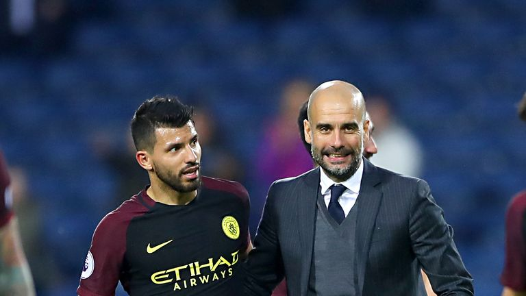 Manchester City manager Pep Guardiola (right) and Manchester City's Sergio Aguero celebrate after the final whistle of the Premier League match at The Hawt