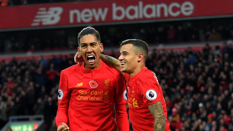 Liverpool's Roberto Firmino celebrates scoring his side's fourth goal of the game with Philippe Coutinho (right) during the Premier League match at Anfield