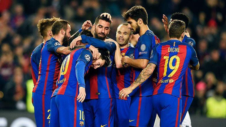 Barcelona's Turkish forward Arda Turan (C) celebrates with teammates after scoring
