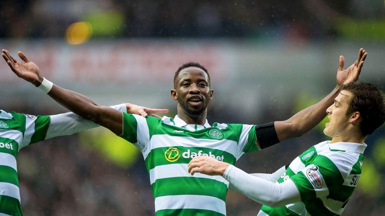 Moussa Dembele celebrates his equaiser at Ibrox Stadium