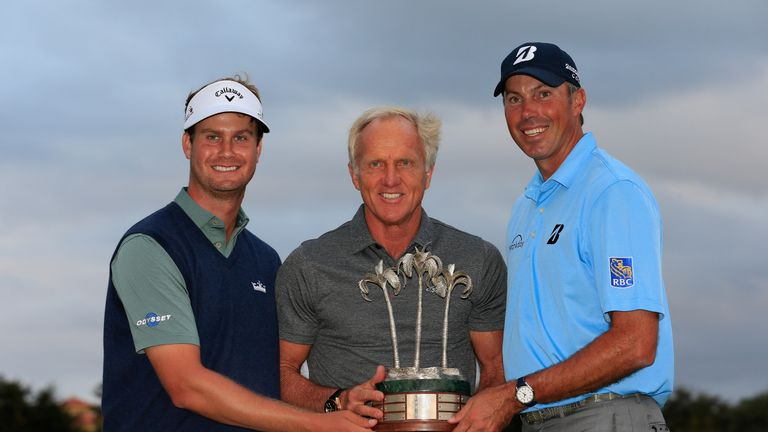 Harris English (left) and Matt Kuchar (right) are presented with their trophy by tournament host Greg Norman