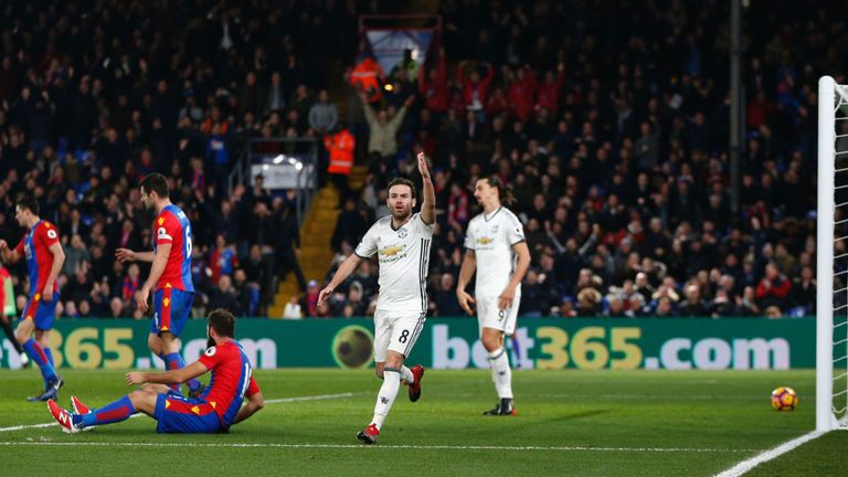 Manchester United midfielder Juan Mata gestures at the assistant referee