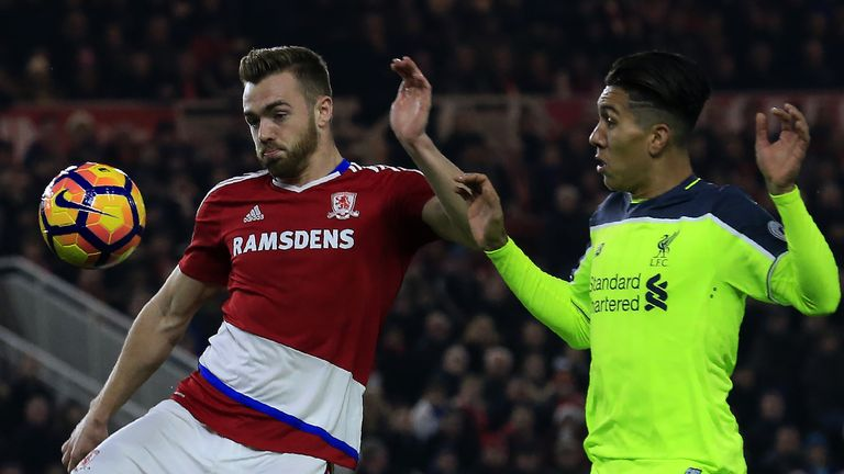 Middlesbrough defender Calum Chambers (L) vies with Liverpool midfielder Roberto Firmino