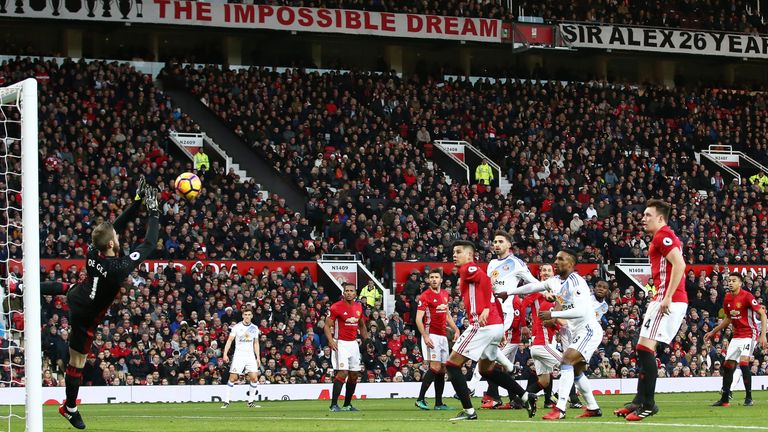 David De Gea makes a save from Patrick van Aanholt's free-kick