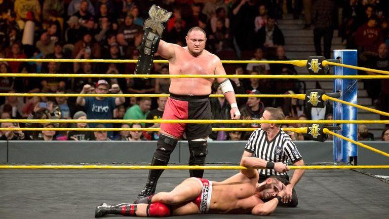 Samoa Joe poses after defeating Tye Dillinger on NXT