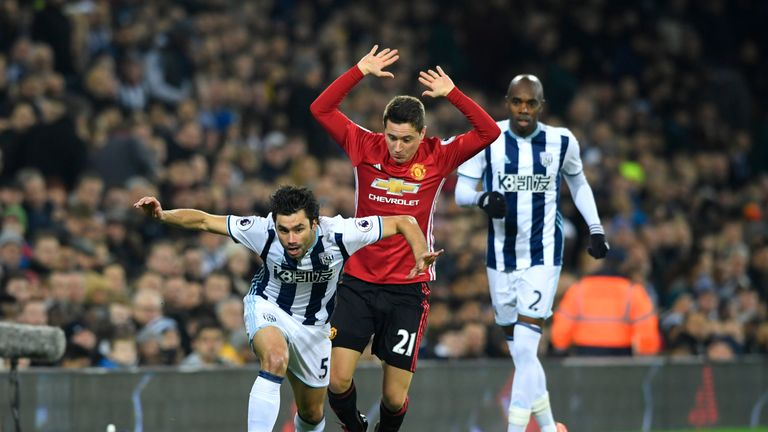 Claudio Yacob is fouled by Ander Herrera during the first half