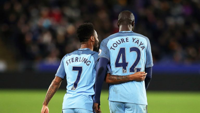 Toure celebrates his goal with team-mate Raheem Sterling